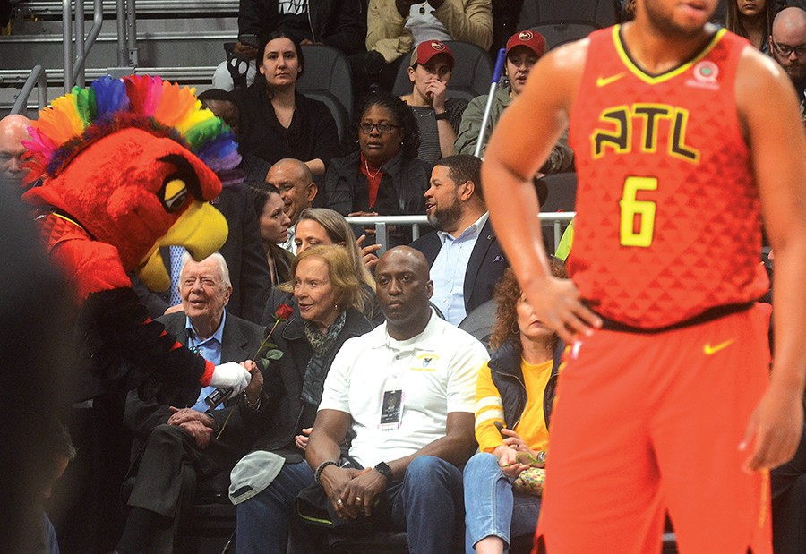 A ROSE IS A ROSE: President Jimmy Carter treated First Lady Rosalyn Carter to the Love Wins! Hawks game, though the home team didn't treat the Carters to a win; Hawks losing to the Knicks, 106 - 91. Photo by Jeff Slate.