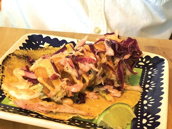 TUZA: The table's best taco — a huge hunk of fried fish draped in pickled cabbage. Photo: Cliff Bostock.