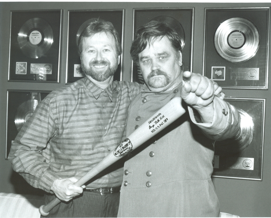 BATMEN: Mark Pucci (left) and Col. Bruce Hampton at the Aquarium Rescue Unit signing (1991). Alan Mayor.