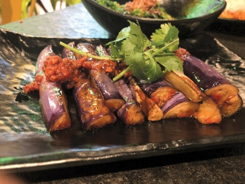 AFTER THE PURPLE RAIN: Food Terminal's creamy eggplant is topped with a spicy sauce. Photo by Cliff Bostock.