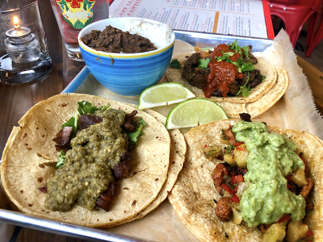 LAZY LLAMA: A trio of tacos with black beans and rice is likely more than you can eat. Photo credit: Cliff Bostock