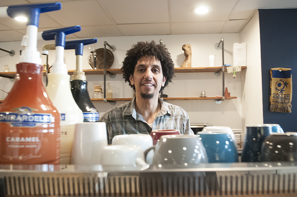 HOW YOU DOIN'?: Barista Ibrahim Arman is responsible for Ébrik's laid back playlists. Photo by Joeff Davis
