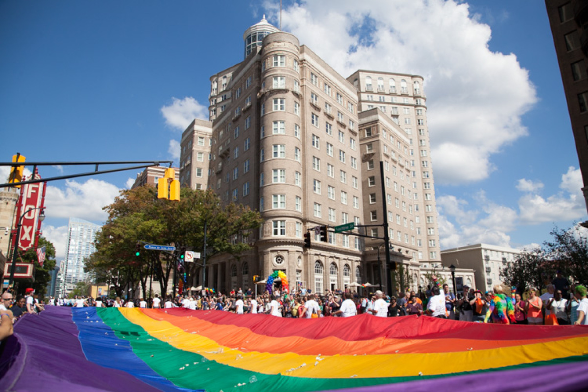 The iconic giant rainbow flag made its way down Peachtree Street.