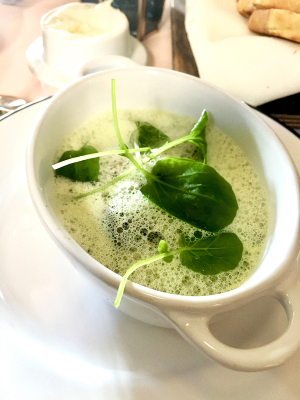 Underneath the verdant foam are Burgundian snails and caper cappelletti. Photo by Angela Hansberger.
